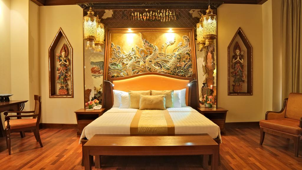 rooms at de naga hotel chiang mai have hardwood floors and asian dcor each air conditioned room has a 26 inch flat screen tv dvd player and fridge
